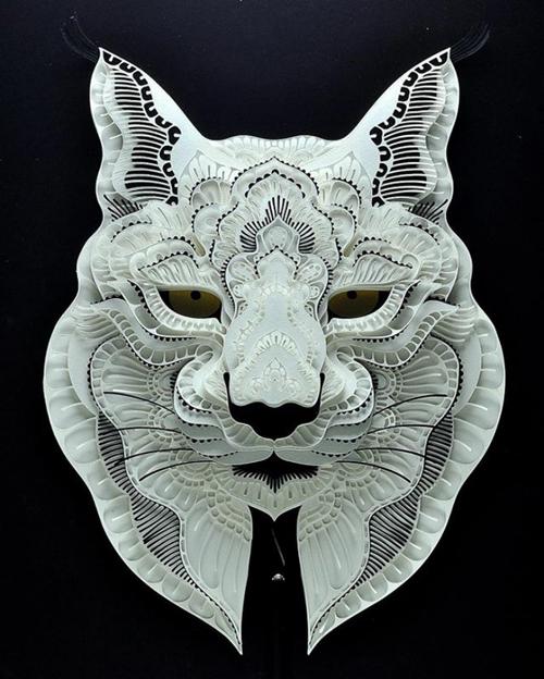 вырезанные портреты животных