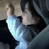 девочка танцует в детском кресле