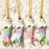ожерелья в виде кошек-русалок