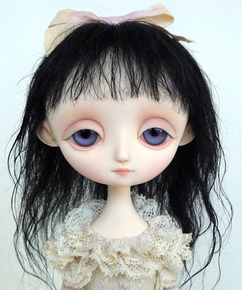 куклы с печальными лицами