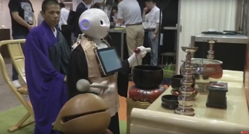 робот проводит погребальный обряд