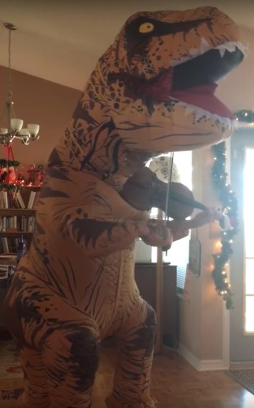 динозавр играет на скрипке