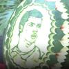 портреты футболистов на арбузах