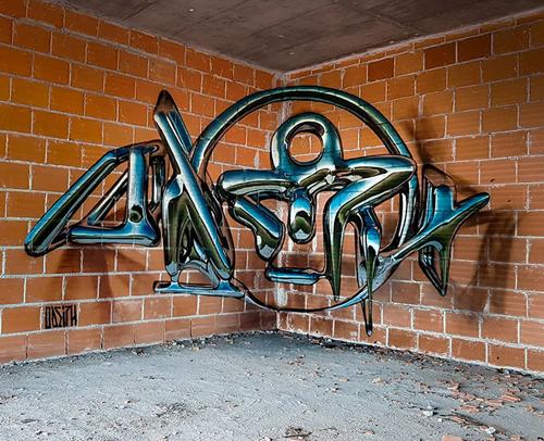 уличный художник и его граффити