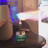освежитель воздуха рядом со свечой