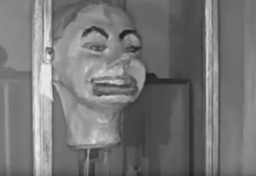 одержимая кукольная голова