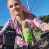 попугай с хозяйкой на велосипеде