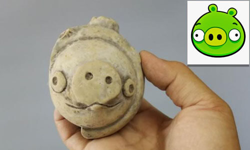 глиняная фигурка свиньи