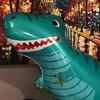 неприличный надувной динозавр