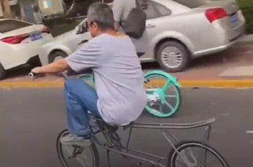 умелец на необычном велосипеде