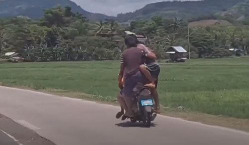 five people on a motorcycle