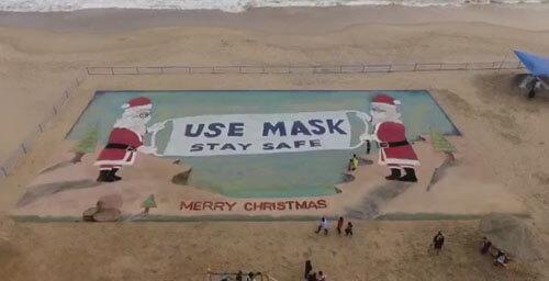 санта-клаусов нарисовали на песке