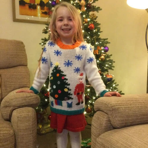 grandmother knitted a sweater for her granddaughter