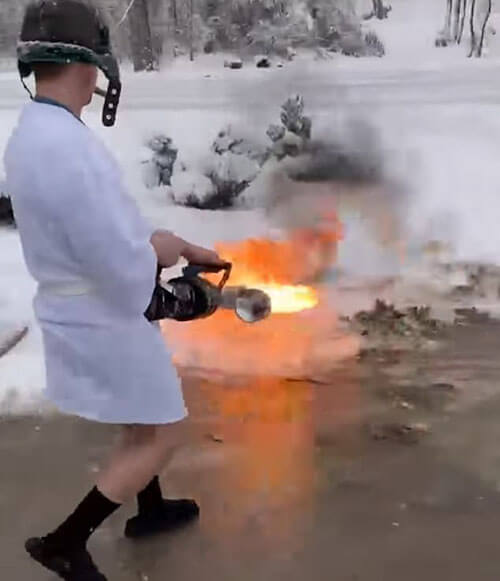 cleaning snow with a flamethrower