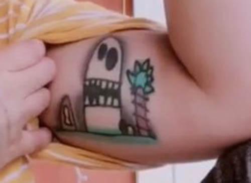 татуировка с рисунком сына